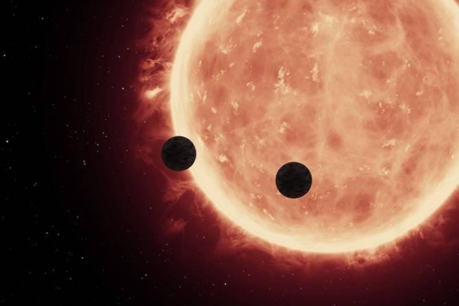 Ilustración de los planetas ante su estrella, una enana roja. (Imagen: NASA/ESA/STScl)